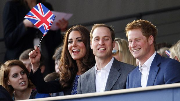 Dressed to impress ... Princess Beatrice, the Duchess of Cambridge and princes William and Harry enjoy the Jubilee Concert.