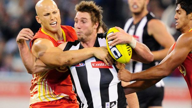 Not having it ... Collingwood's Dale Thomas, centre, made a complaint about the incident.