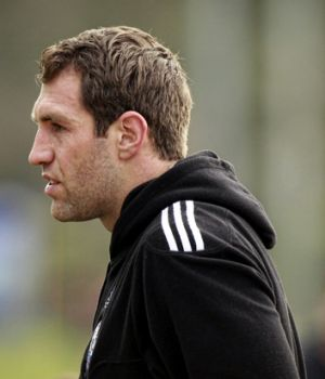 Travis Cloke watches as Collingwood train yesterday.