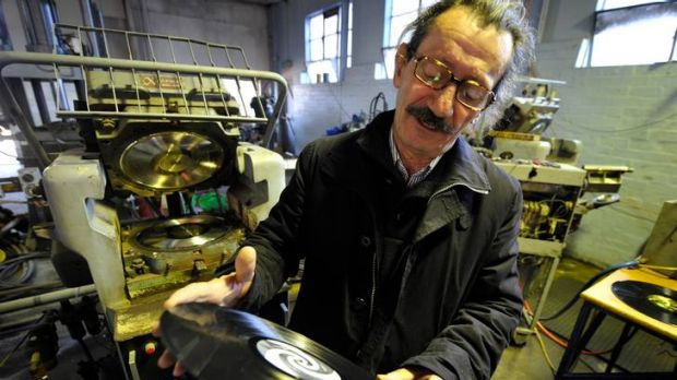 """""""Nothing romantic about it"""": Owner of Zenith Records, Chris Moss, inspects a 12-inch vinyl record that has just been pressed."""