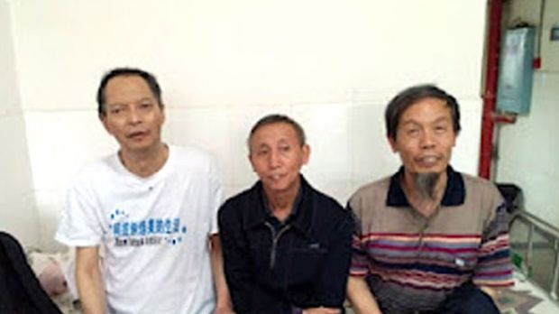 Leading dissident Li Wangyang (left) posing with his friends in Shaoyang, in central China's Hunan province.