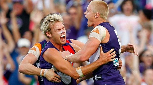 Adam McPhee (right) has signed on to play another season for Fremantle.