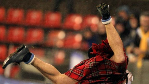 Skirting the issue … a kilted Braveheart gave stewards the runaround at Hunter Stadium after Scotland's win over ...