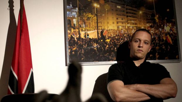 Ilias Kasidiaris poses for a photo at the at the headquarters of the extreme far-right Golden Dawn party, which alarmed ...