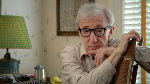 Writer and director Woody Allen takes a break from his typewriter.