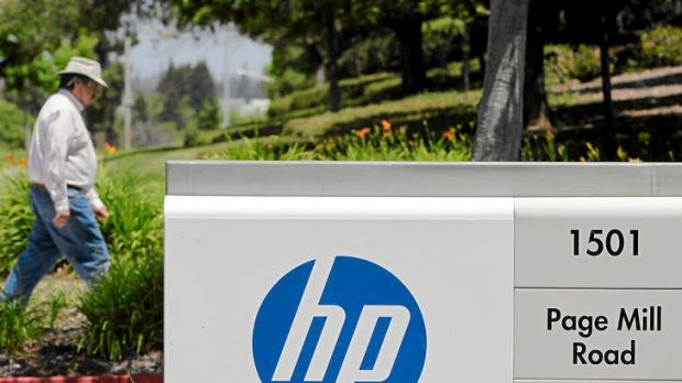 A worker walks into HP's headquarters in Palo Alto, California. The company held is annual customer event in Las Vegas ...
