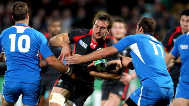 Charging through … Wales's Sam Warburton takes on Namibia at last year's World Cup in New Zealand.