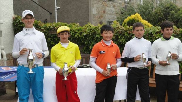 Josh Armstrong, left, towers over his opponents after winning the boys 12-year division of the Junior European ...