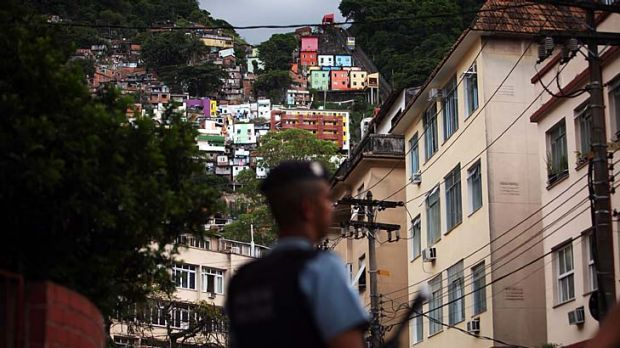 Guardian … a police officer stands on the edge of the ''pacified'' Santa Marta favela. There has not been a murder ...
