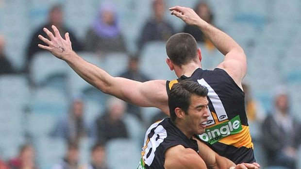 Docker destroyer: Two Richmond defenders are left floundering as Matthew Pavlich claims another mark.
