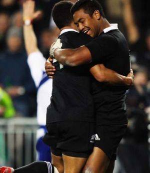 Julian Savea of the All Blacks celebrates with Aaron Smith after scoring a try.