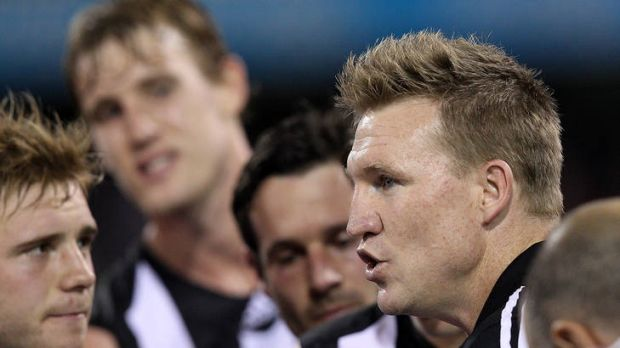Getting his message across: Nathan Buckley has the attention of his players.
