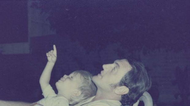 Mystery man … Scott Johnson as a child with his father, above.