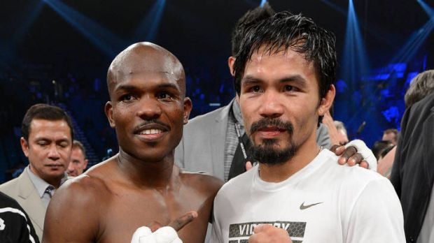 Timothy Bradley and Manny Pacquiao pose for a photo after Bradley defeated Pacquiao by split decision.