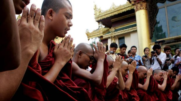Buddhist monks pray in Rangoon over killings in the state of Rakhine, where authorities are trying to prevent the spread ...