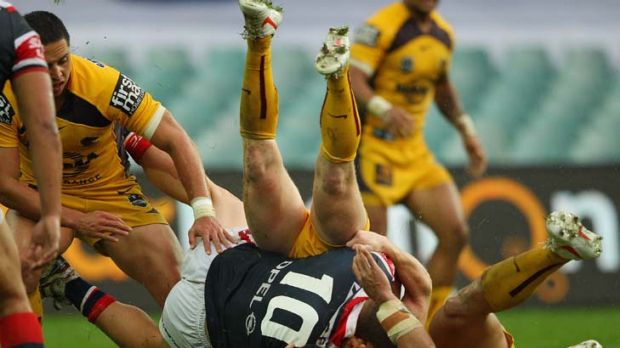 Flightless bird ... Martin Kennedy of Sydney Roosters is taken to the ground in a tackle during yesterday's match ...