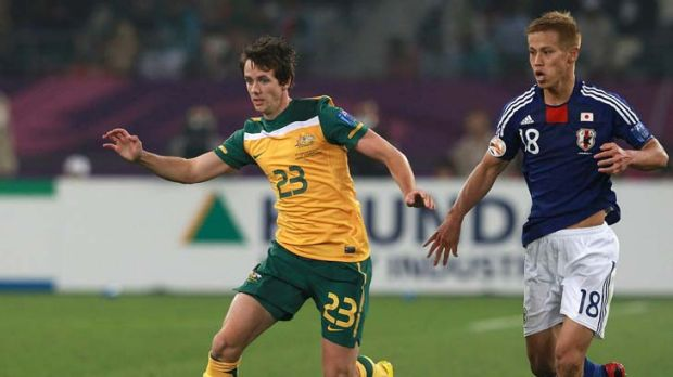 Robbie Kruse gets away from Japan's Keisuke Honda in last year's Asian Cup. The Socceroos hope to do the same tomorrow.