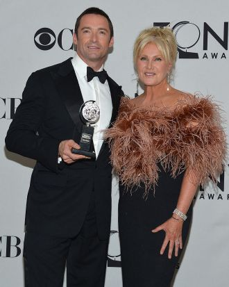Hugh Jackman and wife Deborra-Lee Furness pose with his Tony Award.