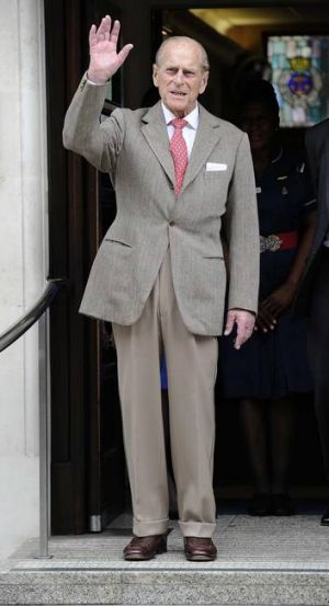 Prince Philip waves as he leaves the King Edward VII Hospital.