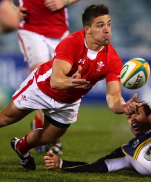 Rhys Webb of Wales manages to offload.