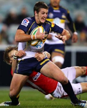 The Brumbies Ian Prior is tackled by Liam Williams of Wales.