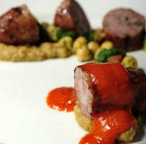 Toulouse sausage with chickpeas, roast zucchini and harissa at Onred.