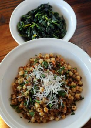 Pasta and lentils, and spinach with garlic and olive oil.