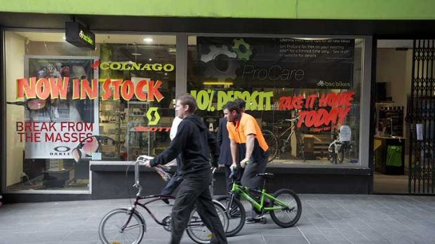 Employees remove stock from BSC Bikes' QV Building store in the city yesterday.