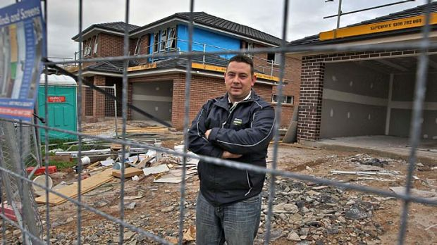"""Supervisor ... Nathan Johnson of Wisdom Homes at a new housing development, Oran Park Town, in Sydney's west. """"The last ..."""