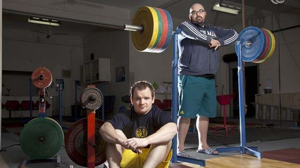 Amazed at teammate's action ... weightlifters Ben Turner and Damon Kelly at training in Brisbane yesterday.