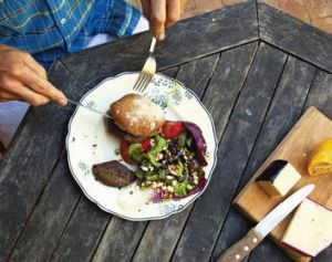 Tucking in … this meal was sourced from a bin (as was the cheese knife).