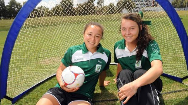 Canberra United's Hayley Raso, right, with teammate Jennifer Bisset.