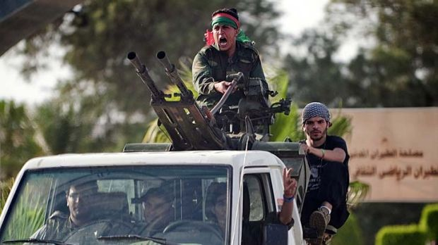 Libyan forces arrive at Tripoli airport after it was overrun by militiamen.