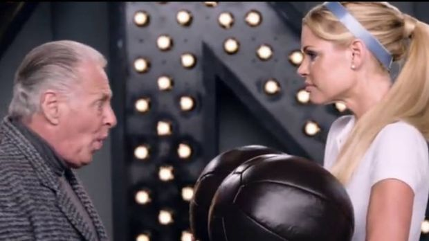 Subtle art ... Sophie Monk returns cleaned balls to an older man.