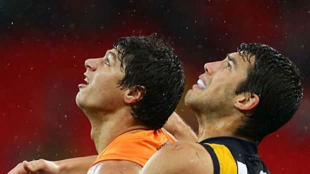 Don't look up: Jonathon Patton and Richmond defender Alex Rance do battle yesterday.