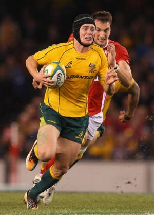 Wallabies flyhalf Berrick Barnes only flew into Melbourne hours before kick-off after being at the birth of his son.
