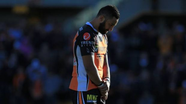 Tigers back Benji Marshall stands with his head bowed during a minute's silence for Robbie Farah's mum, who died on the ...