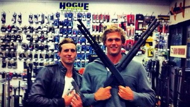 Australian swimmer Nick D'Arcy and teammate Kenrick Monk posing with guns in a picture on D'Arcy's Facebook page. The ...