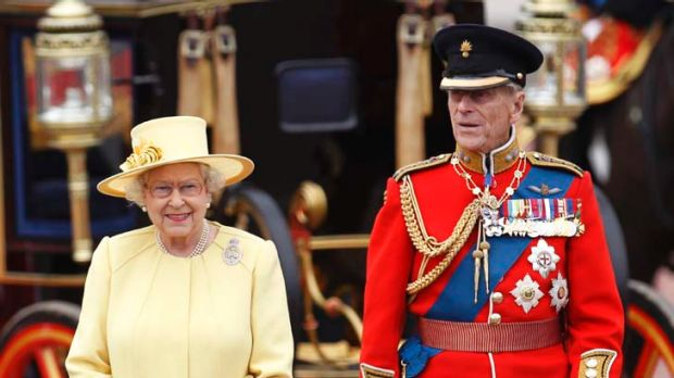 It takes two ... the Queen and Prince Philip take a salute as the Guards march past Buckingham Palace after the Trooping ...