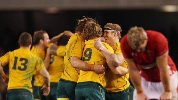Last gasp … Wallabies players celebrate with relief after overcoming a spirited Wales in Melbourne on Saturday.