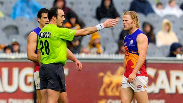In the firing line: Umpire Troy Pannell gives a Hawthorn free kick yesterday.