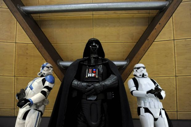 Men dressed as Darth Vader and Imperial Stormtroopers are seen at the Supanova Pop Culture Exhibition at Homebush in Sydney.