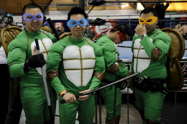 "Men dressed as the ""Teenage Mutant Ninja Turtles"" are seen at the Supanova Pop Culture Exhibition at Homebush in Sydney."