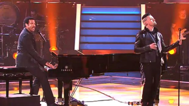 Lionel Ritchie on stage with son-in-law Joel Madden.