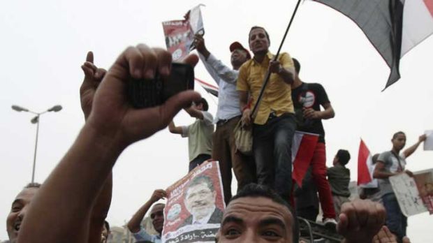 Supporters of Muslim Brotherhood presidential candidate Mohammed Morsi celebrate his proclaimed win at Tahrir Square in ...