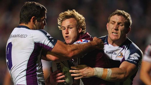 Surrounded ... Daly Cherry-Evans is monstered by the Storm defence.