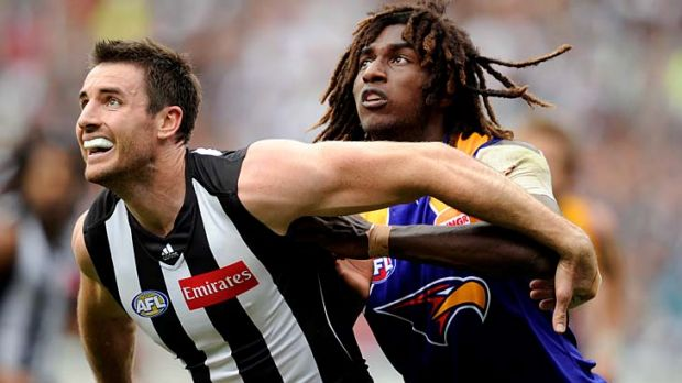 Opposing styles: Magpie ruckman Darren Jolly has problems with the leaping style of the Eagles' Nic Naitanui.