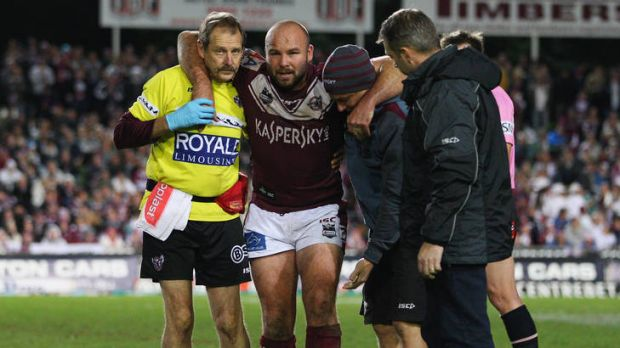 Glenn Stewart is helped from the field with a knee injury last night.