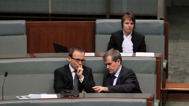 Greens MP Adam Bandt and Workplace Minister Bill Shorten talk during question time this afternoon.