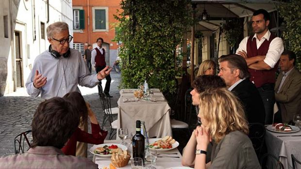 Director Woody Allen, standing left, talking with the cast during the filming of <i>To Rome With Love</i>.